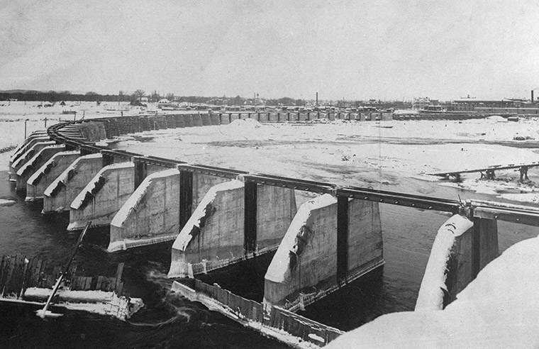 Stop log dam across the Ottawa River, above Chaudière Falls, December 29, 1908.  Photo credit: Canada. Dept. of Public Works / Library and Archives Canada